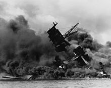 The USS Arizona burning after the Japanese attack on Pearl Harbor [photo source: wikipedia]